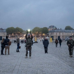 French Soldier Photographing the Gates of Versailles