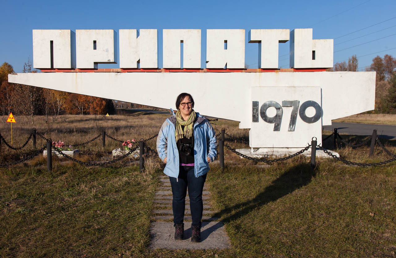 Neeley standing in fron the Pripyat 1970 sign