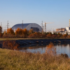 Chernobyl Reactor 4, with the sarcophagus over it, and the new containment unit (left) being built