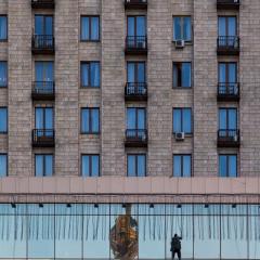 Window washer on the Hotel Ukraine